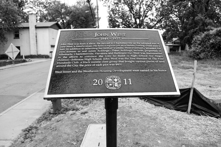 A plaque celebrating John West in the 10th and Page neighborhood.